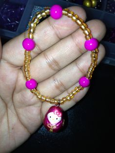 Pink and Gold Bead Bracelet with Hello Kitty charm