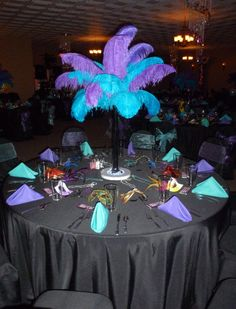 Tall center piece with feathers... but the bottom needs something. Maybe a vase with water pearls and LED base on the bottom