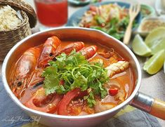 Ingredients 10 large prawns 1 squid 1 packet oyster mushrooms 1 canned button mushrooms (halved) 2 large tomatoes (cut eight) 3 b. Thai Recipes, Asian Recipes, Soup Recipes, Healthy Hearty Soup, Thai Tom, Paste Recipe, Goong, Chilli Paste, Fresh Lime
