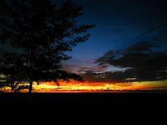 sunset silhouette of the beach at marriott resort and spa miri sarawak malaysia