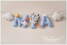 A pretty personalised felt name banner made of different coloured felt, with decorative rope for hanging it. Do you know all symbolic meanings of this beautiful birds? :) Its purity, good luck, fidelity, renewal, new birth, creativity, longevity, prosperity, protection, motherhood...