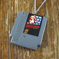 NES Nintendo Game Necklace Ha! I need this! ;)