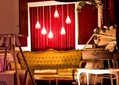 "We've gone all out with our vintage style ""chic"" photobooth set. Those pedant lights have antique style edison globes for a real vintage feel in every picture."
