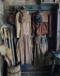 Primitive prairie farm dress at Sweet Liberty Homestead. Brown homespun and brown calico. Perfect for your old peg rack!