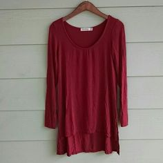 HEART HIPS high lo tunic top Dusty maroon/reddish color. Scoop neck. Long sleeve. Bottom is high low hem. I never wore this but tags are not attached, it doesn't fit me. There is a small snag on the back, can be seen in last pic. 95% rayon 5% spandex boutique Tops Tunics