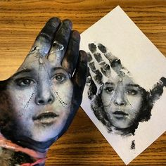 School Teacher Paints Realistic Portraits On His Hand And Stamps Them On Paper