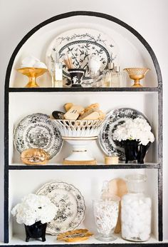 Eddie Ross  styled shelves in black and white with a touch of gold