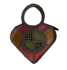 HEART SHAPED HAND-BAG MADE FROM WOVEN ARROW CANE & SYNTHETIC LEATHER IN MULTIPLE COLORS.