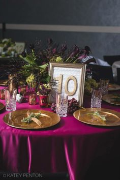 Table 10 featured a large arrangement in a gold bowl. The arrangement featured deep purple calla lilies, deep purple tulips, mini green hydrangeas, plums, mixed berries, and red grass. Smaller gold vases were filled with mini green hydrangeas and mixed berries. The table was covered with a lipstick colored linen borrowed from Table Covers and More. The NotWedding was held at the W Hotel in Buckhead. Photo credit: Katey Penton Photography.