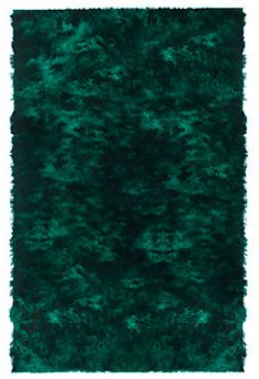 The deep emerald green of this shag rug is so luxurious and that's the color I covet!