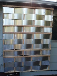 metal flashing and furring strips to create a screen to hide that unsightly electricity box and water meter!