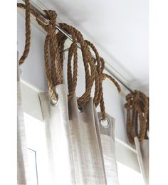 Love this! Plain Jane white curtains (like) just add rope.