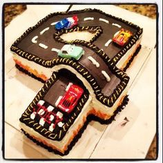 Birthday Racetrack Cake this is awesome! Aiden either wants dinos or race cars for his next birthday. This is pretty cool! Birthday Racetrack Cake this is awesome! Aiden either wants dinos or race cars for his next birthday. This is pretty cool! 4th Birthday Cakes, Fourth Birthday, 3 Year Old Birthday Cake, Car Birthday, Happy Birthday, Fancy Cakes, Cute Cakes, Race Car Cakes, Car Cakes For Boys