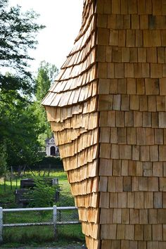 A skin of chestnut shingles covers the facade of this multipurpose building at a school in the French town of Hostens