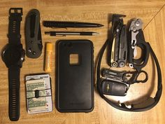 """Elis EDC submitted by bevisedc Garmin Fenix 5X Sapphire - Slate Gray with Black Band Benchmade Griptilian Oakley Flak 2.0 Smith & Wesson SWPENMPBK Military and Police Tactical Pen Black Nite Ize S-Biner #3 Gerber Dime Leatherman MUT EOD Leatherman RAPTOR Lifeproof FRE SERIES iPhone 6/6s Waterproof Case (4.7"""" Version) - Retail Packaging - GRIND (DARK GREY/SLATE GREY/SKYFLY BLUE) Zebra F-301 Burts Bees Beeswax Lip Balm"""