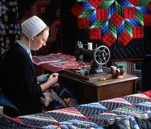 Amish Woman at Sewing Machine. I want an Amish quilt for my bed. Such beautiful work.