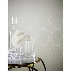Pearl Savoy Wallpaper: Savoy is a lovely white wallpaper featuring a circle design. The pearl shimmer in this pattern is sure to brighten your home. Paste the wall technology means that Savoy is easy to hang!
