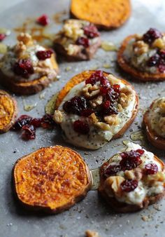 cinnamon sweet potato rounds with herbed goat cheese, roasted walnuts, cranberries, and honey