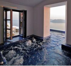 Outdoor/indoor hot tub. Overlooking the ocean.   Give it to me now!