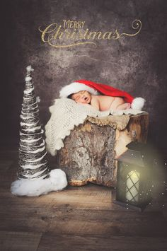 A newborn baby using our log prop and adding a bit of Christmas sparkle too this little ones newborn portrait session. book today from £50
