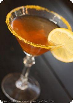Sweet Tea Lemon Drop Martini      (•1 1/4 ounce Sweet Tea Vodka  •1/4 ounce triple sec  •3/4 ounce lemon juice  •Colored sugar in yellow  •Candied lemons for garnish)
