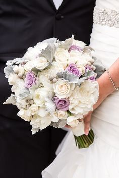 Pastel bridal bouquet: lavender roses, white peonies, creamy white roses, and dusty miller leaves by Pink Dahlia Floral and Event Design | The Park Savoy Estate, Northern NJ |  Idalia Photography