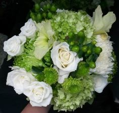 Modern chic bridal bouquet of green and white flowers... roses, hydrangea, mums, gladiolus, and hypericum berries ... Expressed in Blooms Floral Design by Carol Heisey #ExpressedInBlooms #summerwedding #greenwedding