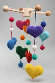 This crib mobile toy - decorated with many hearts - is a nice present for a family that just got a baby. Via en.DaWanda.com.