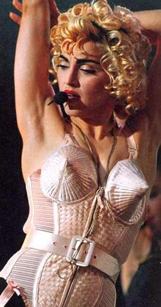 Here is Madonna and her cone bra, which Jean Paul Gaultier designed for her. Jean Paul Gaultier, Divas, Madona, Lady Madonna, 1980s Madonna, Madonna Photos, French Fashion Designers, Cone Bra, Material Girls