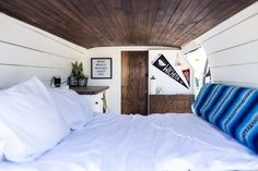 Van conversion inspiration. Minimal design. Dark wood. Cozy bed. #vanlife #vanlifediaries #vaninspiration #vandwellers #projectvanlife #digitalnomad #nomad #vanconversion #travelmore #exploretocreate