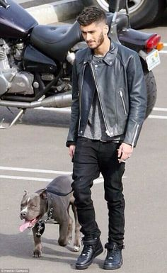 """Zayn Malik goes from dressing up as """"Veronica"""" in the Best Song Ever video to wearing a leather jacket while leading a pitbull. nbd"""
