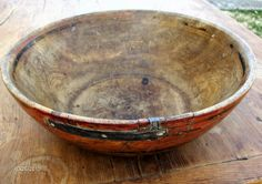 Early burl bowl with original polychrome paint decoration of black stripes on a red/orange ground. Iron strap repair to shrinkage crack. Steve Shelton at Whitehorse Antiques (SOLD).