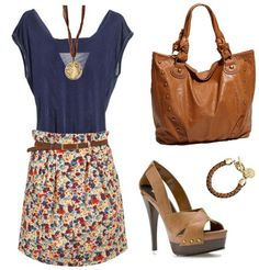 cute outfit! layer a solid colored shirt with a patterned skirt