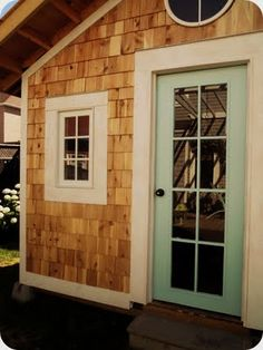 aqua door, cedar shingles I plan on shingling my parents house and painting the front door a more tropical blue