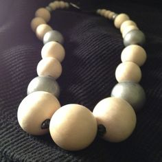 "The Wonder of Wood Beautiful statement necklace. Round wooden beads, natural with silver colored accents; on black knotted leather. 18"" long. Ralph Lauren Jewelry"