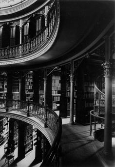 The library stacks in the Bacon Art and Library Building, c. 1894. Library collections numbered 80,000 volumes, and the campus had 815 students and 60 faculty members.