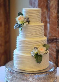 Stunning. A beautiful wedding cake, finished with a #rustic buttercream finish. Dressed with white roses.