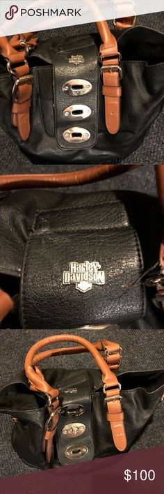 Harley Davidson purse Large Harley purse.. very little wear along straps. (See pictures). Leather black with tan straps. I also have the matching wallet. Harley-Davidson Bags Shoulder Bags