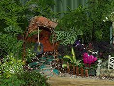 Fairy garden. Love the tire swing