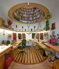 Round Bookcase for Saving Space by Travis Price Architects