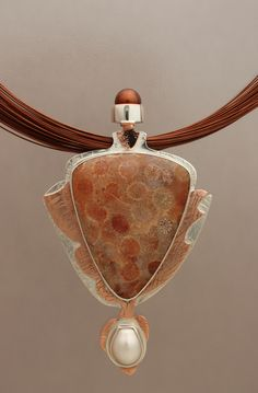Fossilized Coral pendant from 2010, silver, copper and Henna Pearl