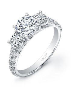 Uneek three-stone engagement ring with round center set in 14K white gold I Style: USM015RD2-6.5RD I https://www.theknot.com/fashion/usm015rd2-65rd-uneek-fine-jewelry-engagement-ring?utm_source=pinterest.com&utm_medium=social&utm_content=june2016&utm_campaign=beauty-fashion&utm_simplereach=?sr_share=pinterest