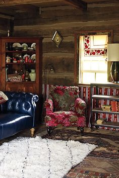 I like the layers & the rug/tapestry/fabric thingie on the wall in back of the bookcase.