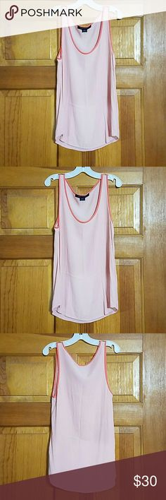 French Connection Peach Tank Top French Connection Peach Tank Top Size US 4 Light Peach Colored Body and Darker Peach Trim Around Neck and Arms  Practically New 100% Viscose  Cold Water Wash RN 53372 French Connection Tops Tank Tops