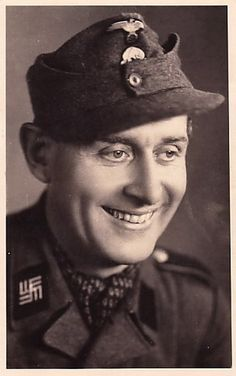 An SS-Schtüze of the SS-Mannschaft. Note the double-armed Swastika on his collar tabs used from 1944 on to identify full-time concentration staff  who had been compulsorily transferred in from the Wehrmacht, SA, Werkschutz or similar non SS organizations. They were never considered SS personnel as their being conscripts rather than volunteers.