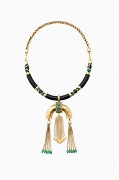 The Odeon Pendant Necklace makes a big statement with a tassel-adorned pendant in leather and green. Shop tassel statement necklaces at Stella
