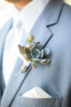 Succulent and Peach Hypericum Berry Boutonniere rests against a dusty blue groom's suit Succulent Boutonniere, Succulent Bouquet, Groom Boutonniere, Classic Wedding Themes, Wedding Colors, Wedding Flowers, Wedding Bouquets, Wedding Dresses, Blue Groomsmen