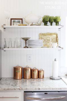 I'm loving her combination of rustic vintage decorations and modern open concept shelves!  thewhitebuffalostylingco.com
