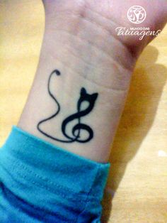 The perfect tattoo for those who love both cats and music!