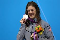 Silver medallist Allison Schmitt of the United States poses on the podium during the medal ceremony following the Women's 400m Freestyle final on Day 2 of the London 2012 Olympic Games at the Aquatics Centre on July 29, 2012 in London, England